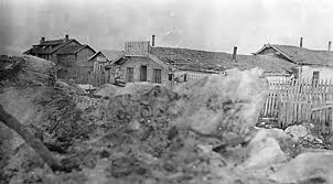 old photo shows Fort Yukon from vantage point in excavated pit