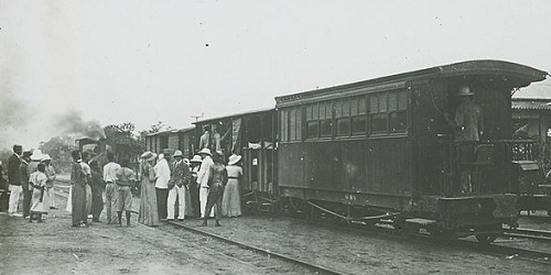 Missionaries board steam locomotive in Congo about 1900.